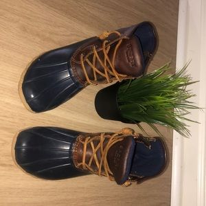 navy blue and brown leather Sperry boots